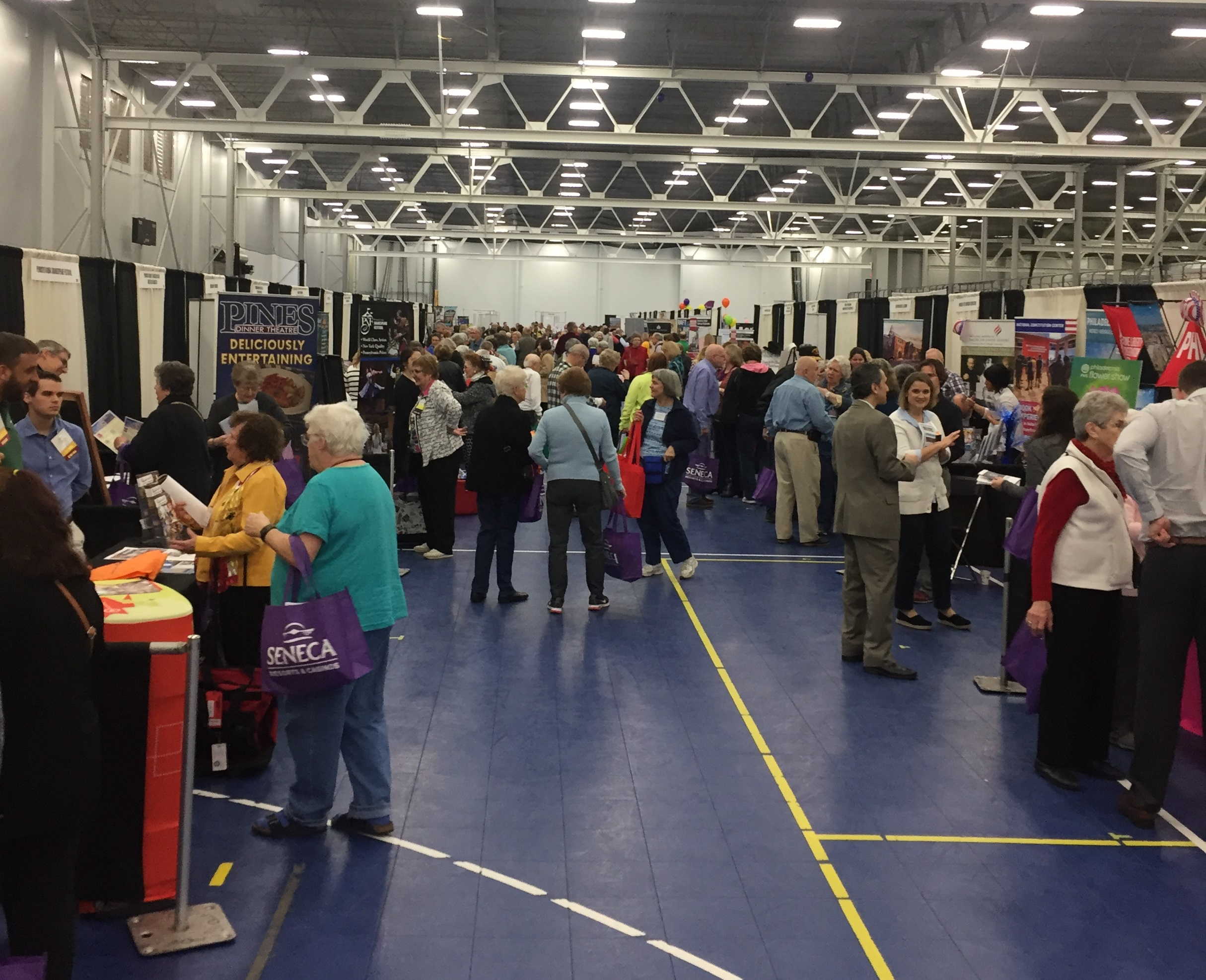 Group Leaders talking with Exhibitors